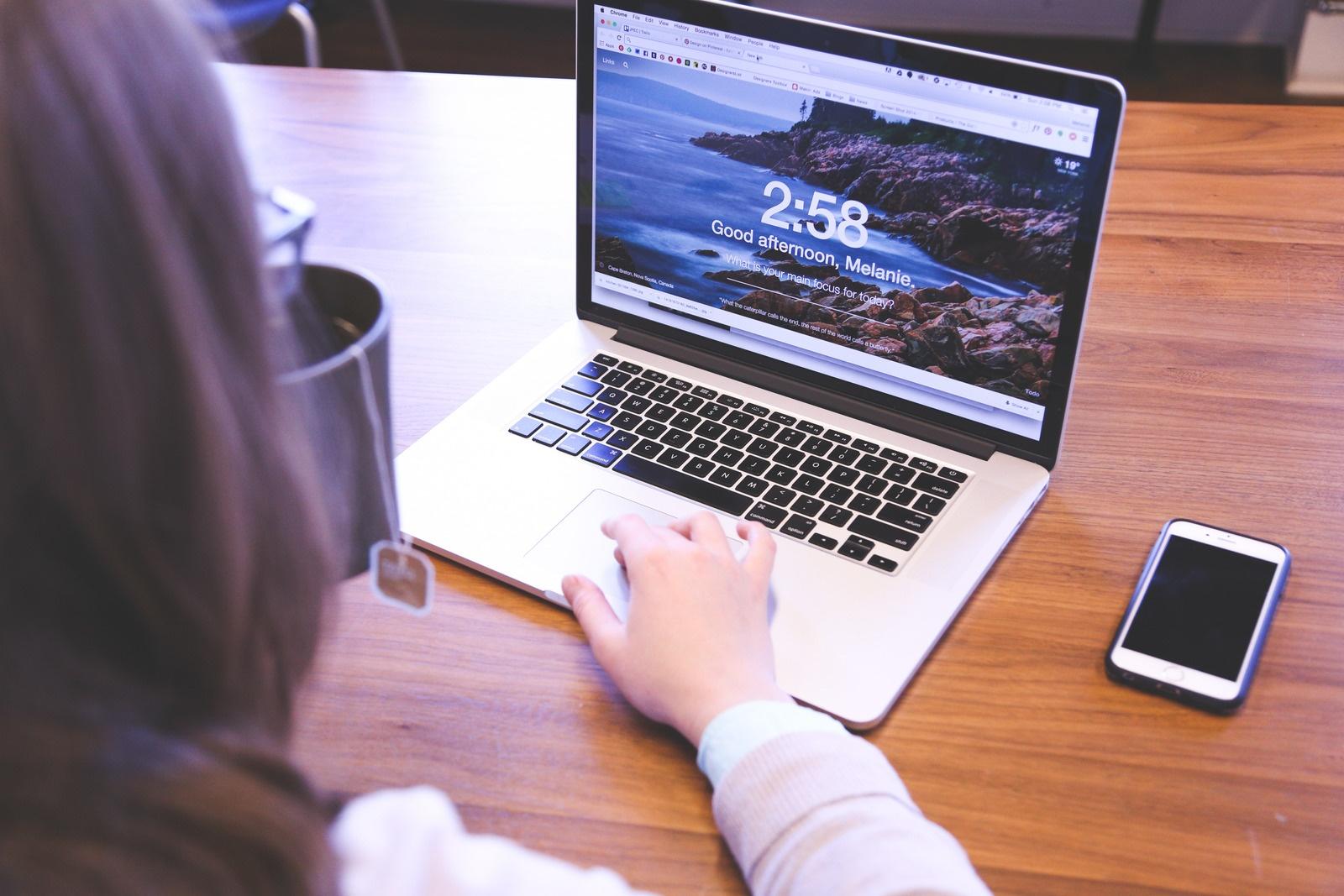 canva-woman-using-macbook-pro-on-table-MADGyAqCAvw